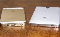 """iPhone在华份额再涨 苹果狠狠""""咬""""了小米一口"""